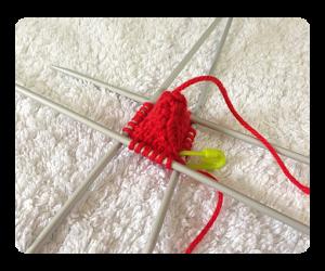 Strawberry knitting progression round 10